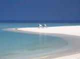 joga na pláži Anantara Kihavah